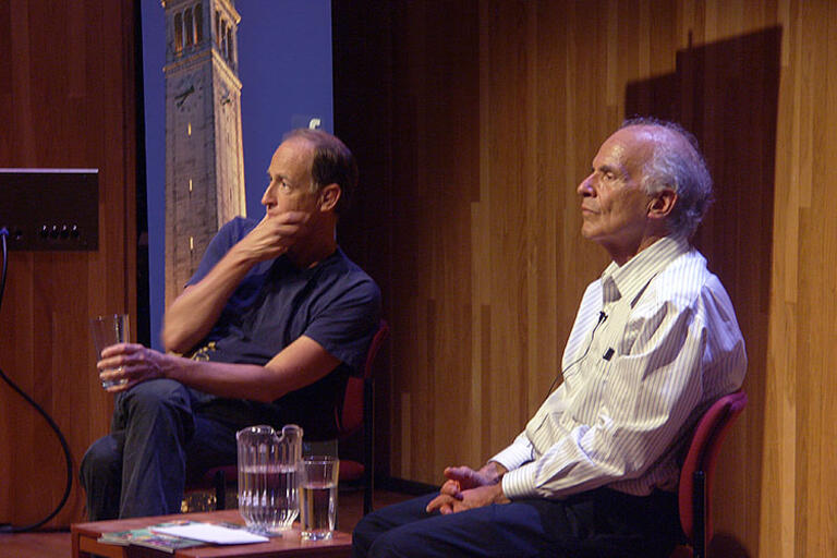 Charles Ferguson taking questions from the audience, seating next to Harley Shaiken