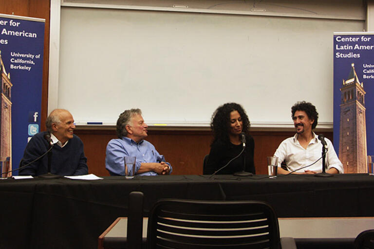 CLAS Chair Harley Shaiken moderates a discussion with Lowell Bergman, Daffodil Altan, and Andrés Cediel. All seated in front of the audience