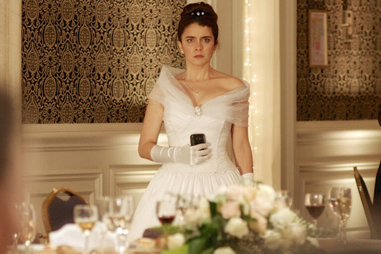 A bride holding a glass