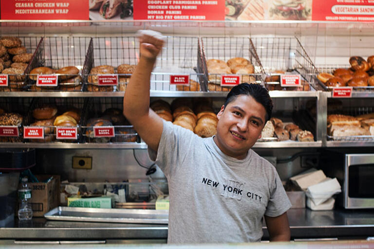 """One of the workers featured in """"The Hand That Feeds."""" A man standing in front of a bakery"""