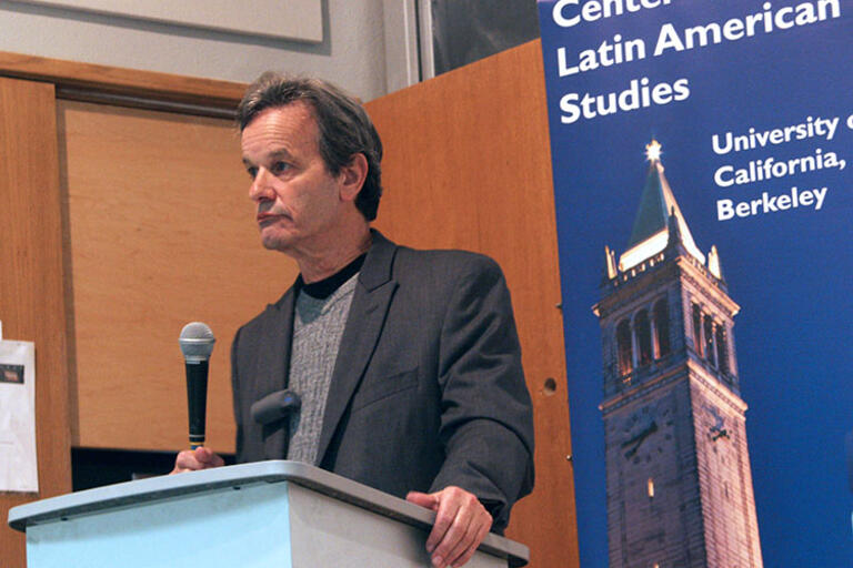 Jeffrey L. Gould speaking with a microphone