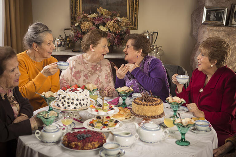 """Five ladies having tea around a table. Still from """"Tea Time"""""""
