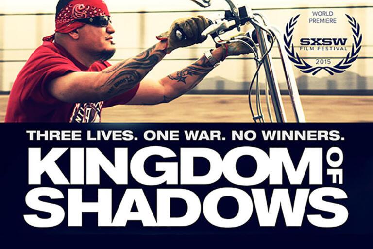 "Man driving a bike, still from ""Kingdom of Shadows"""