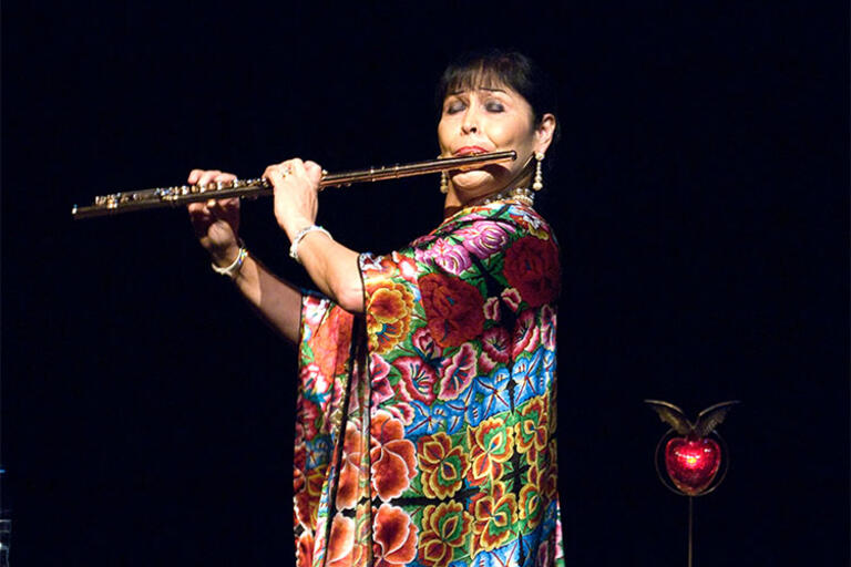 Elena Duran playing the flute
