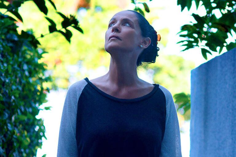 Actress Sonia Braga looking up the sky