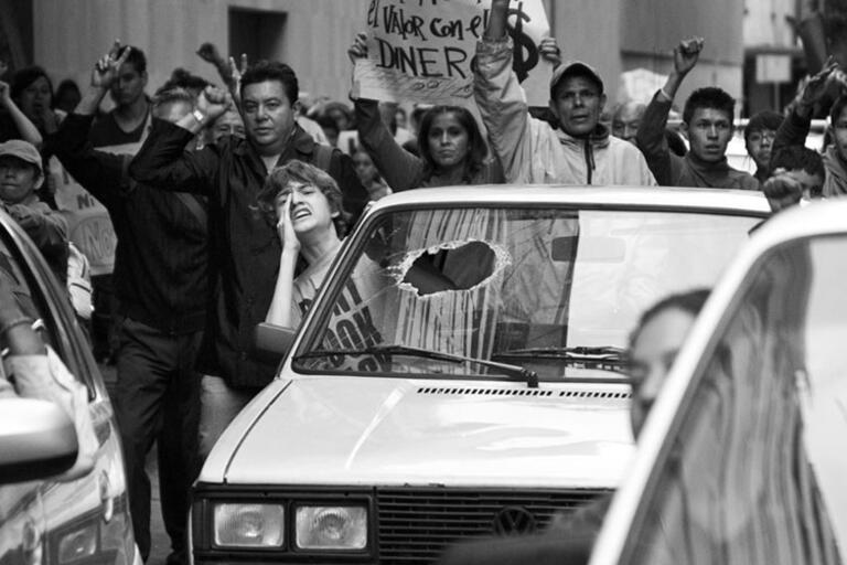Black and white still from Güeros, people protesting