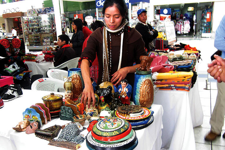 A fair to promote local products, necklaces being displayed