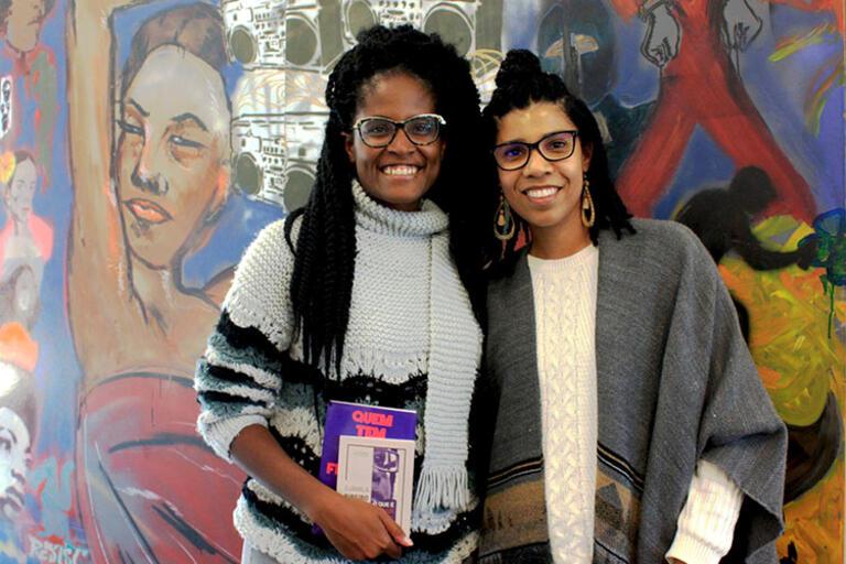 Djamila Ribeiro (right) of the Movimento de Feministas Negras, standing up