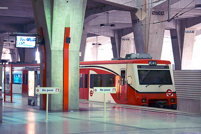 A commuter train waits in a Mexico City station