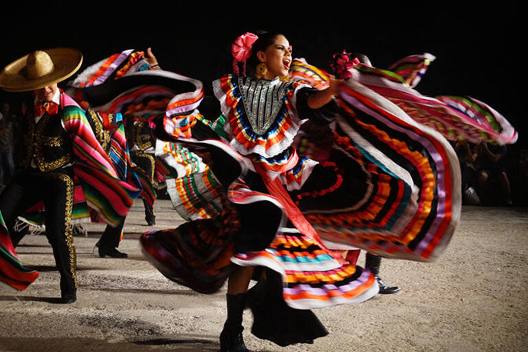 Mexican dancer wearing a colorful dress
