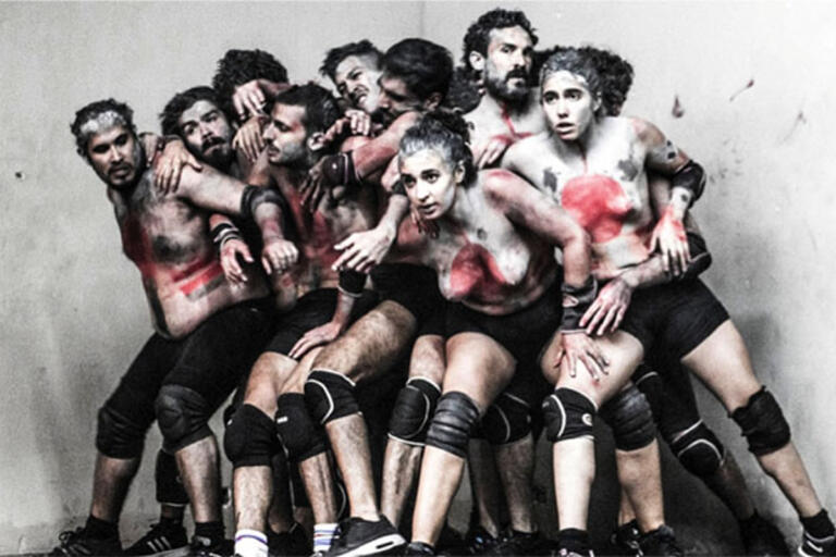 Artistic photography of a group of people covered in white paint
