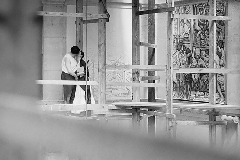 Diego Rivera and Frida Kahlo kiss on the scaffolding in Detroit. (Photo courtesy of the Detroit Institute of Art.)