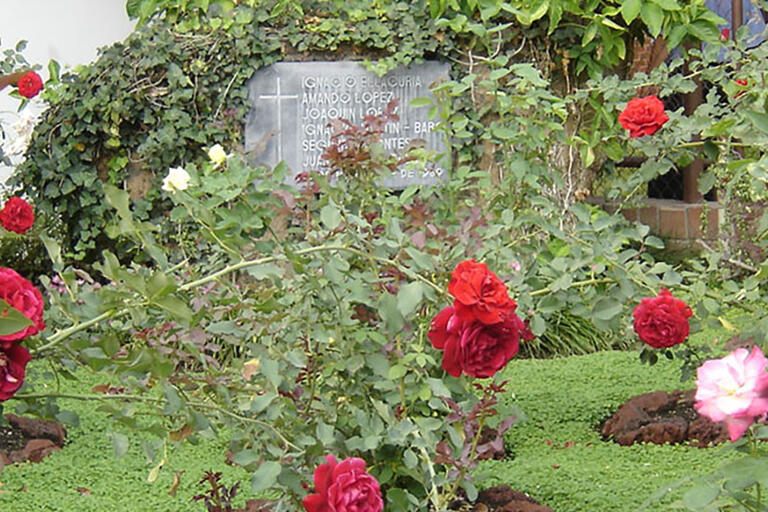 A rose garden and memorial planted at the site of the murders of six Jesuit priests, their housekeeper, and her daughter in El Salvador. (Photo by John Donaghy.)