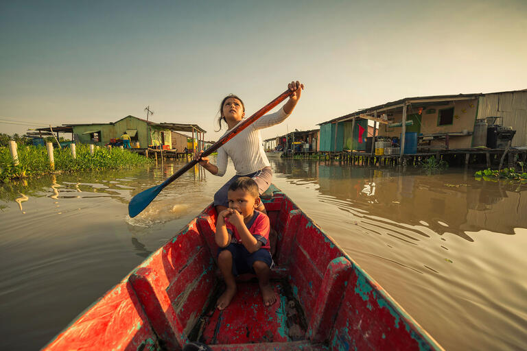 Children in a boat, from Once Upon a Time in Venezuela. (Photo by John Márquez.)