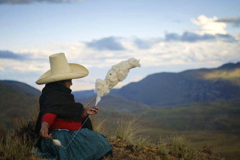 Máxima Acuña spins wool from her sheep. (Image courtesy of TrustFall Films.)