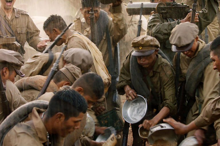 Still showing Bolivian soldiers in the rain during the Chaco War. From the film Chaco. (Image courtesy of Murillo Film.)