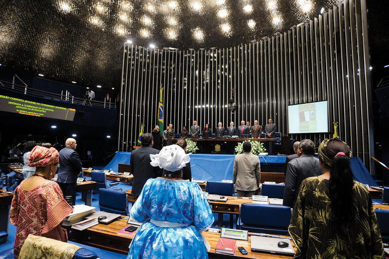 A ceremony featuring AfroBrazilian women leaders in commemorating the abolition of the slave trade in Brazil's senate chamber. (Photo courtesy of Senado Federal do Brasil.)