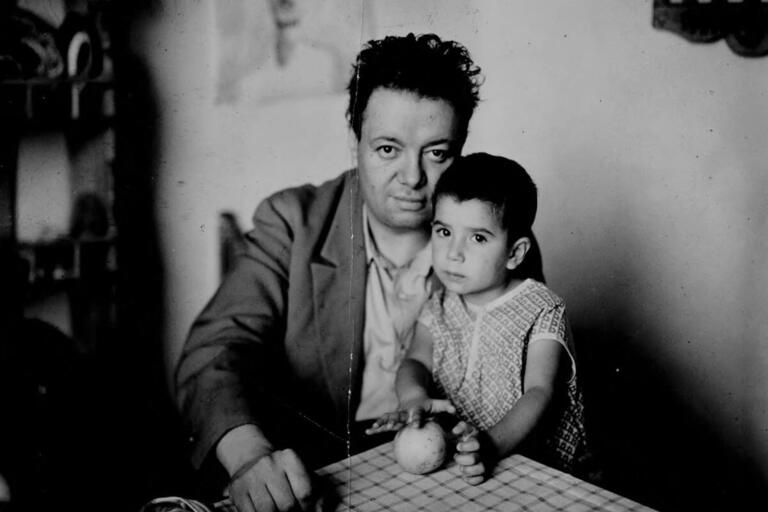 Diego Rivera sits with his toddler daughter Guadalupe on his lap, circa 1927. (Photo from Google Art Project/Wikimedia Commons.)