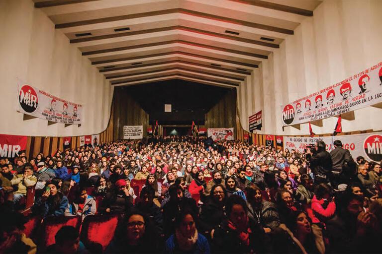 A large gathering of former members in a conference hall, commemorating the 50th anniversary of the Movimiento de Izquierda Revolucionaria, Concepción, Chile, August 2015. (Photo by Esteban Ignacio Paredes Drake.)