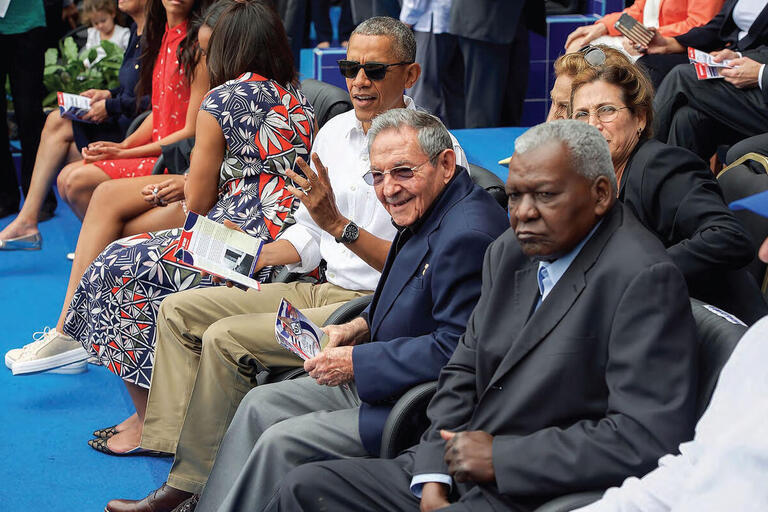 Barack Obama and his family take in a baseball game in Havana with Raúl Castro in March 2016. (Photo from the U.S. Department of State.)