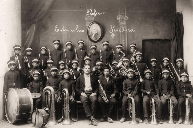 A Latin American military-style boys' band poses with their instruments, 1903. (Photo from Wikimedia Commons.)