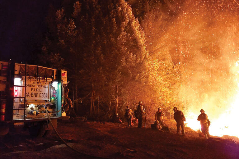 A photo of firefighters battling the Camp Fire in northern California, 2018. (Photo courtesy of Pacific Southwest Region 5, U.S. Forest Service.)