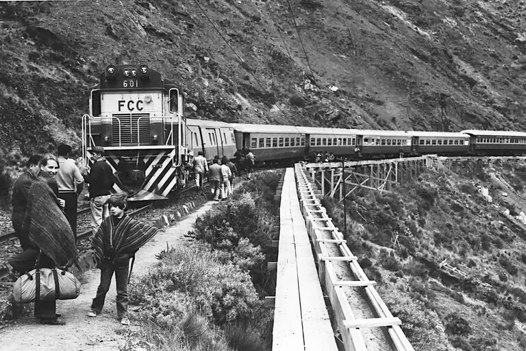 The author and his mother wait by their train in the Peruvian Andes. (Photo courtesy of Peter Andreas.)