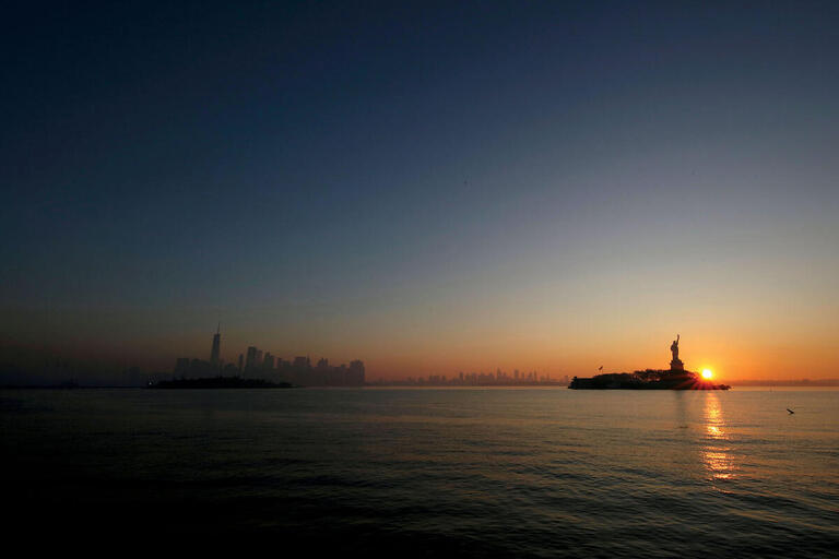 The Statue of Liberty at dawn, November 2020. (Photo by Aaron M. Sprecher/AP Photos.)