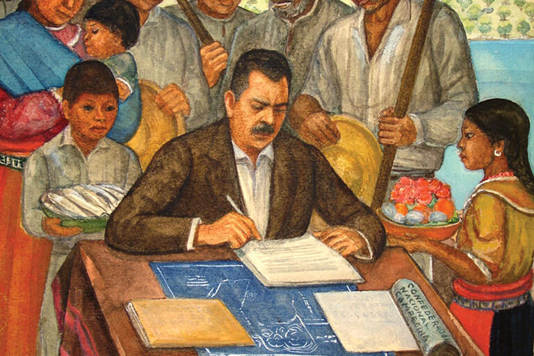 A painting of Lázaro Cárdenas signing the dramatic land redistribution law as Mexico's president. (Photo by Jujomx.)