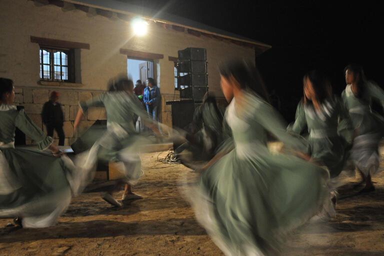 Local Indigenous women whirling through performing a traditional dance at the Museo Rural Communitario Barranca Larga, El Bolsón, Argentina. (Photo courtesy of Alejandra Korstanje.)