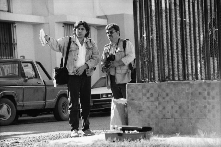 Zeta reporter Sergio Haro and a photographer working in the streets of Tijuana. (Photo courtesy of Quiet Pictures.)