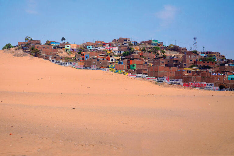 A spreading desert in the foreground for the isolated town of Lurín, Peru. (Photo by Kristian Golding.)