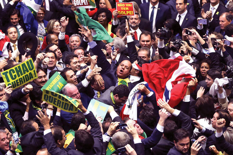 The Brazilian Chamber of Deputies is a scrum of struggling lawmakers during the impeachment vote, April 2016.  (Photo by Marcelo Camargo/Agência Brasil Fotografias.)
