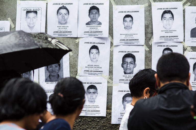 A display of photos and posters highlighting the missing Ayotzinapa students. (Photo by Jorge Mejia Peralta.)
