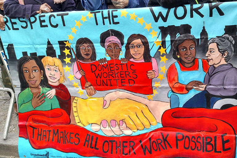 Mural painting that reads Respect the work, Domestic workers united, and that makes all other work possible