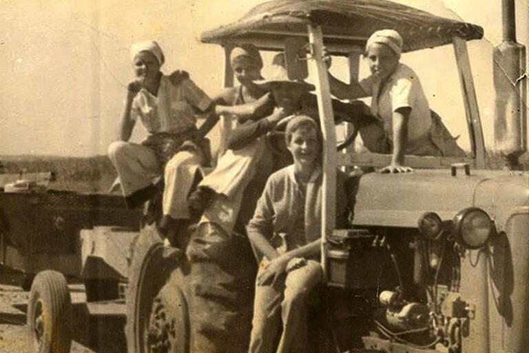 Cuban students seating on a truck