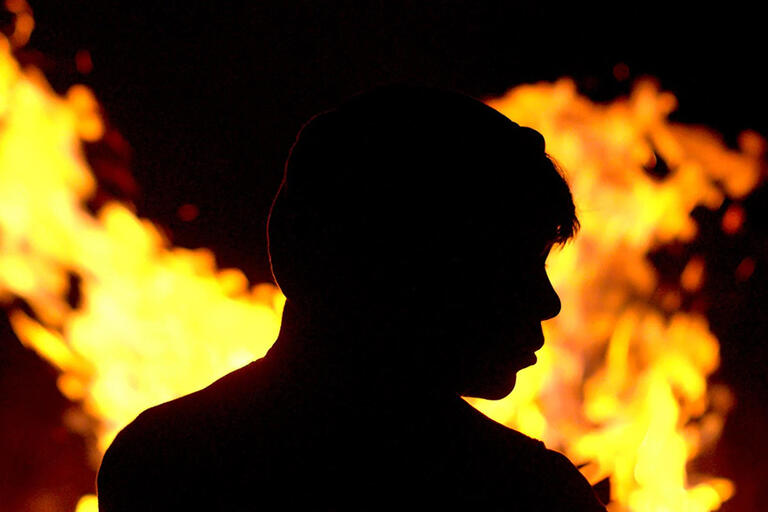 Kid's silhouette against fire