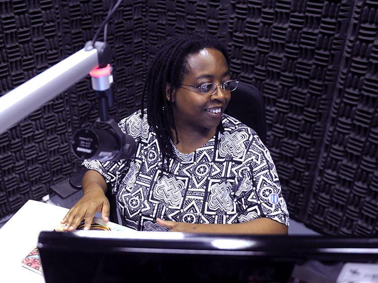 Cidinha da Silva seating at a recording studio