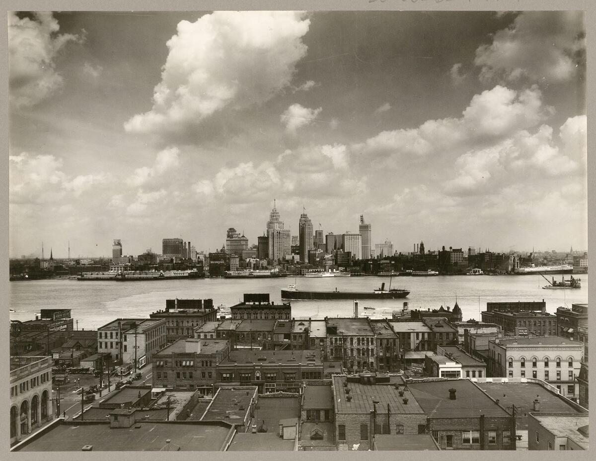 An ore carrier plies the Detroit River towards the Ford Rouge plant, as seen from Windsor, Ontario, circa 1930. (Photo by the Detroit Publishing Company/Library of Congress.)