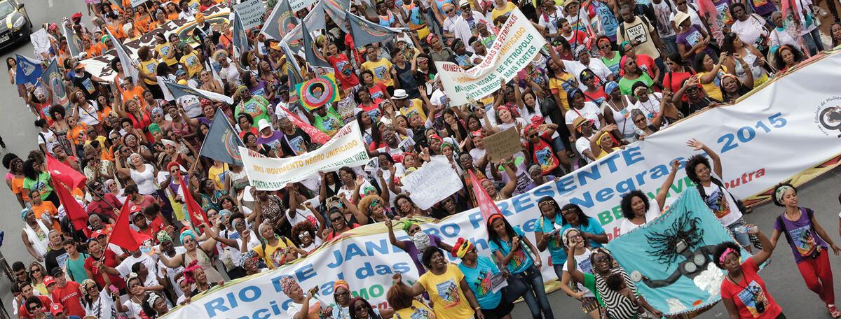 A 2015 women's march crowds the streets in Brazil, with calls for greater respect for Black Brazilian citizens and culture. (Photo by Janine Moraes, Courtesy of Secretaria Especial da Cultura do Ministério da Cidadania, Brazil.)