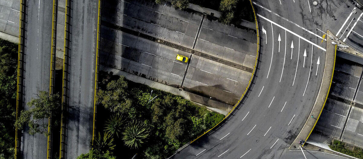 Empty highways with one yellow car