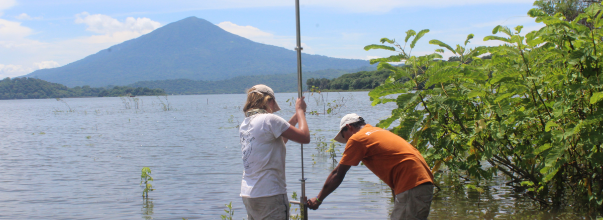 A Berkeley student and a research collaborator take measurements in a lake