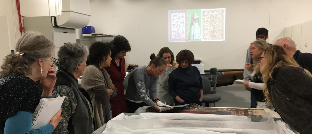 Group of teachers looking at fabric on a table