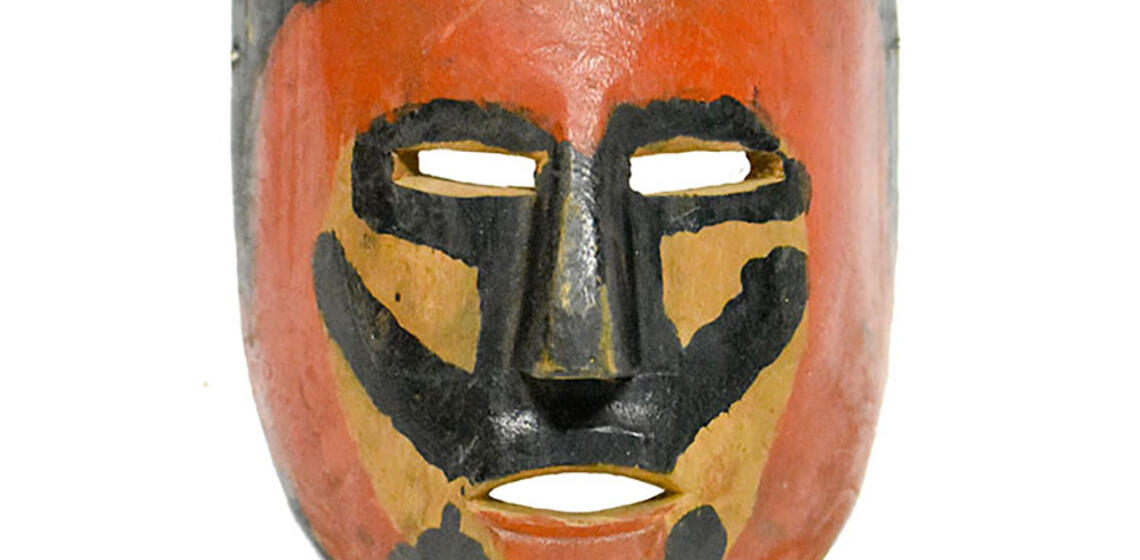 Red and black mask. (Mexico, 20th Century, Polychrome paint on wood.) (Image courtesy of The Mexican Museum.)