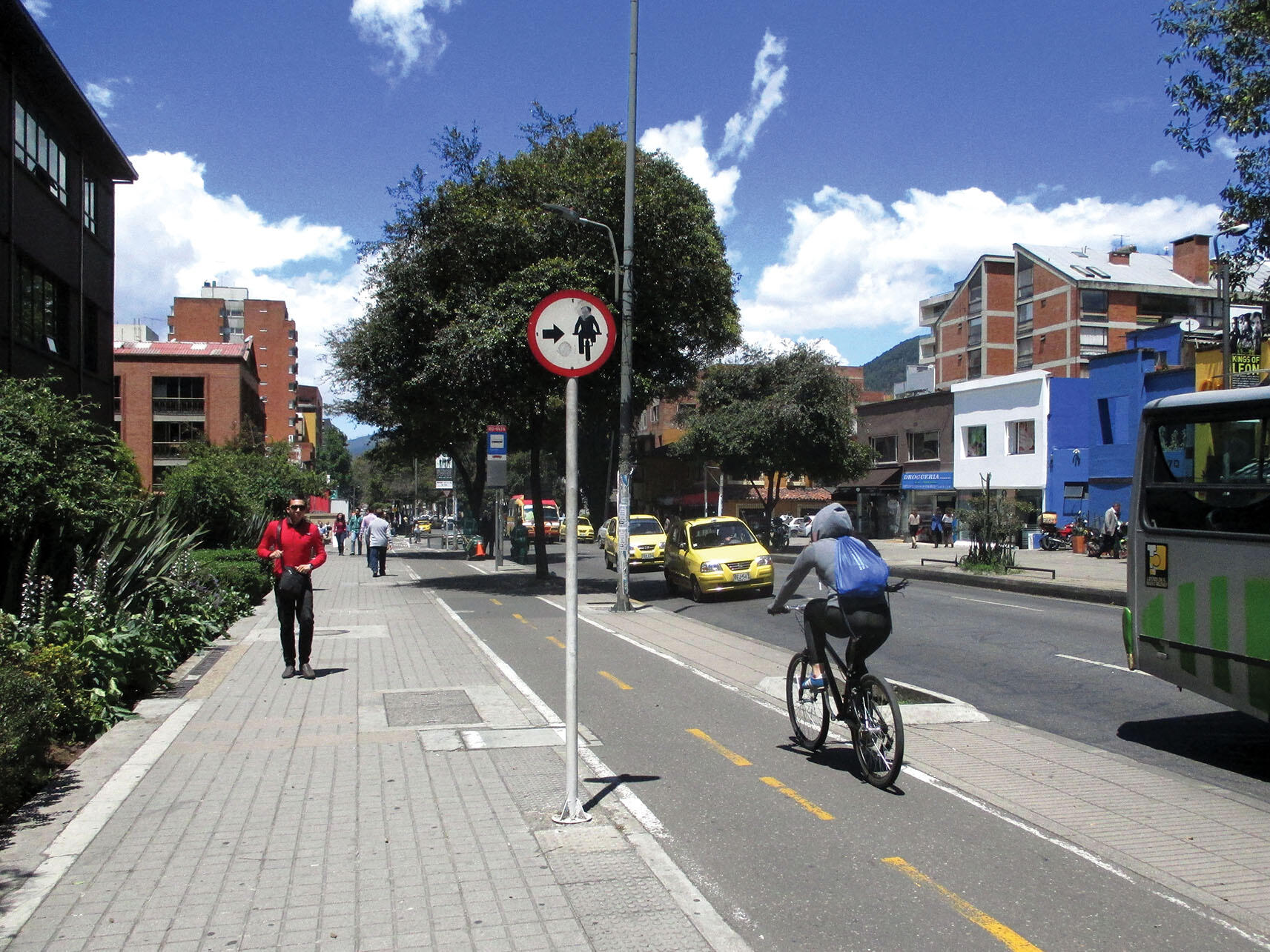 Cyclists and walkers are shown using new pedestrian and cycling paths in Bogotá. (Photo by Pedro Felipe/Wikimedia.)