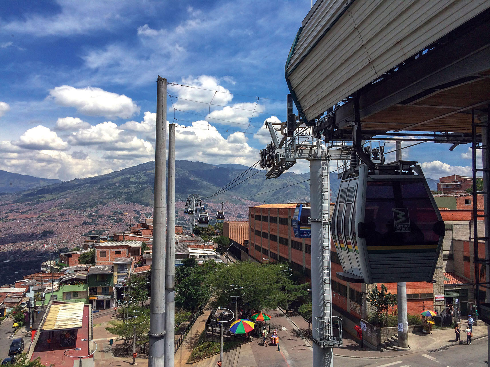 The tramway and a station of Medellín's Metrocable, which links poor hillside communities with the urban center. (Photo by Alan.)