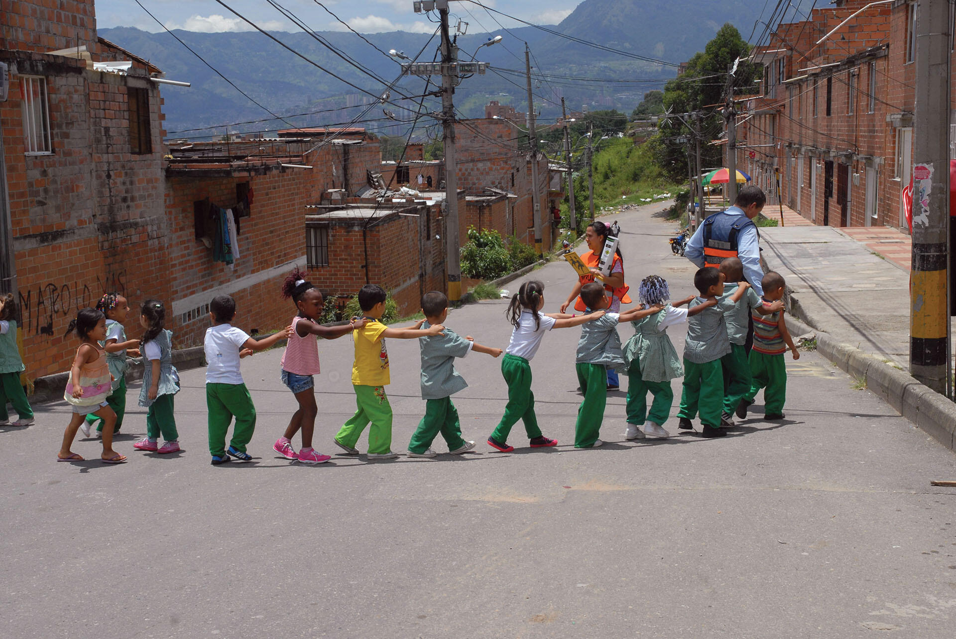 A group of colorfully clothed Medellín schoolchildren participate in an exercise program. (Photo courtesy of Secretaría de Movilidad de Medellín.)