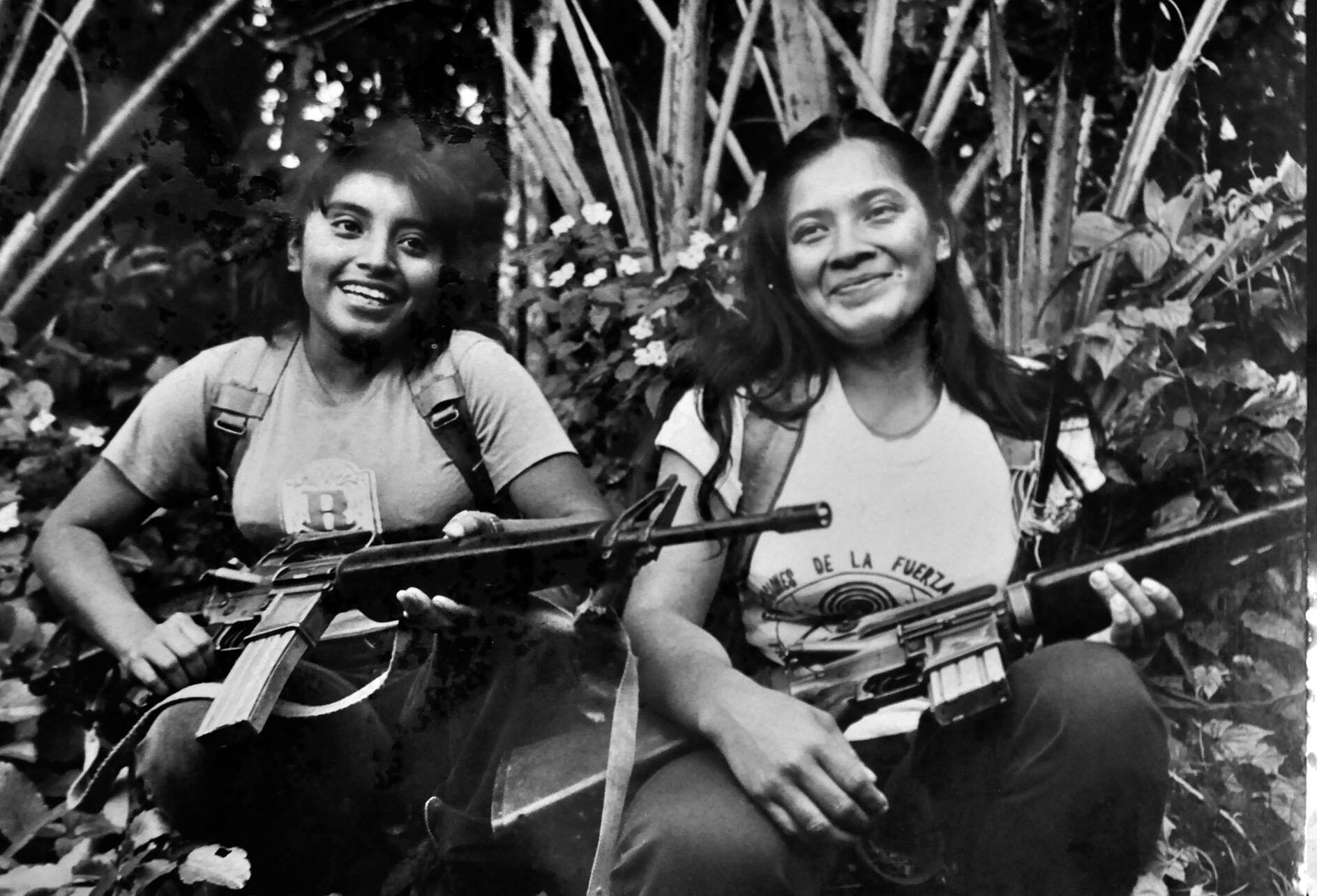 Two women Farabundo Martí National Liberation Front (FMLN) fighters holding guns smile at being photographed. (Photo courtesy of the Museo de la Revolucion, Perquin, El Salvador.)