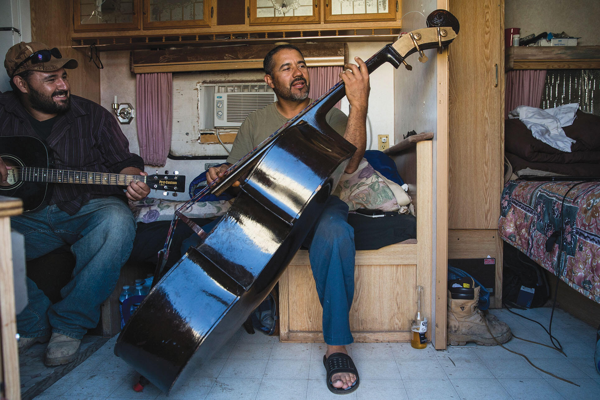 North Dakota has seen an influx of workers, such as these playing Latin American music, from around the globe due to its recent oil boom. (Photo by Andrew Burton/Getty Images.)