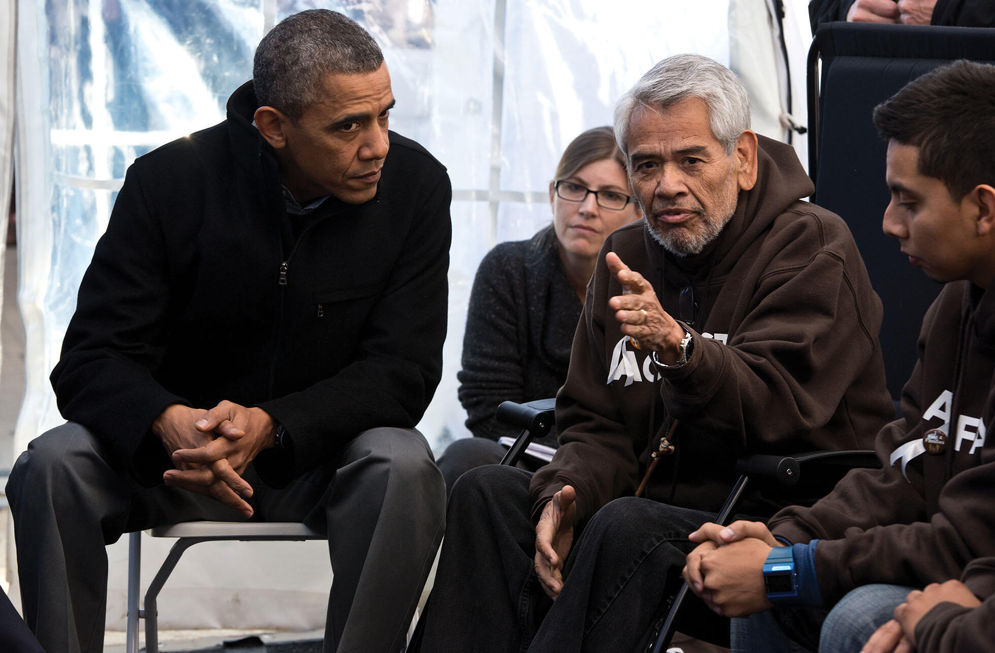 President Obama meets with Eliseo Medina, former executive vice president of the Service Employees  International Union, who was camped outside the U.S. Capitol and fasting for immigration reform, December 2013. (Photo by Nicholas Kamm/AFP/Getty Images.)